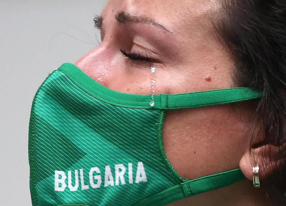 <p>Silver Medalist Antoaneta Kostadinova of Bulgaria sheds a tear during the July 25 medal ceremony of the 10m air pistol women's event on July 25. </p>