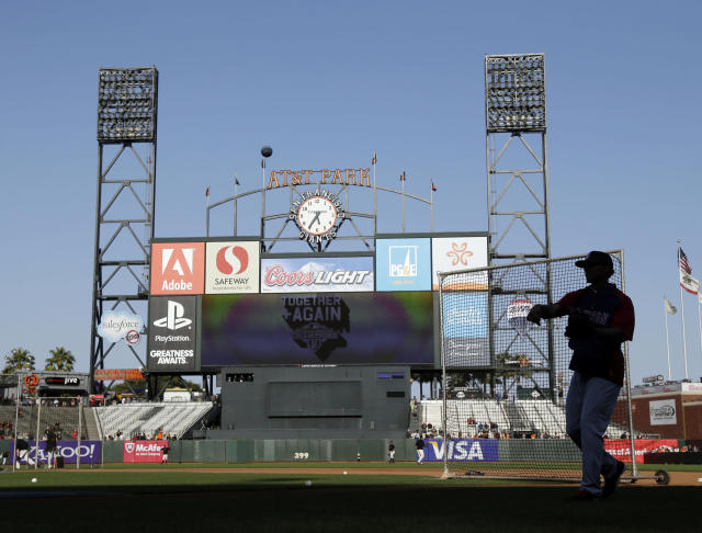 Boston Red Sox's Xander Bogaerts, right, is silhouetted as he warms up before a baseball game against the San Francisco Giants on Monday, Aug. 19, 2013, in San Francisco. (AP Photo/Marcio Jose Sanchez)