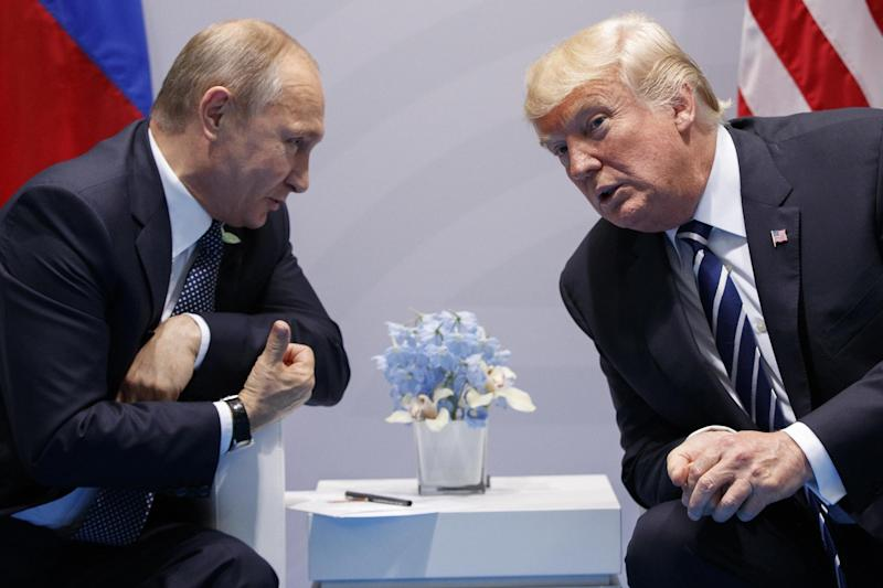 Donald Trump, right, revealed that Vladimir Putin, left, had bragged about Russian prostitutes, according to the memos: AP