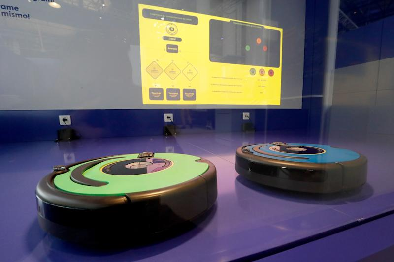 """Roomba"", a robotic vacuum cleaner, is displayed during the exhibition ""Robots"" at the City of Science and Industry or La Cité des Sciences et de l'Industrie in Paris on April 01, 2019. Photo: FRANCOIS GUILLOT/AFP via Getty Images"