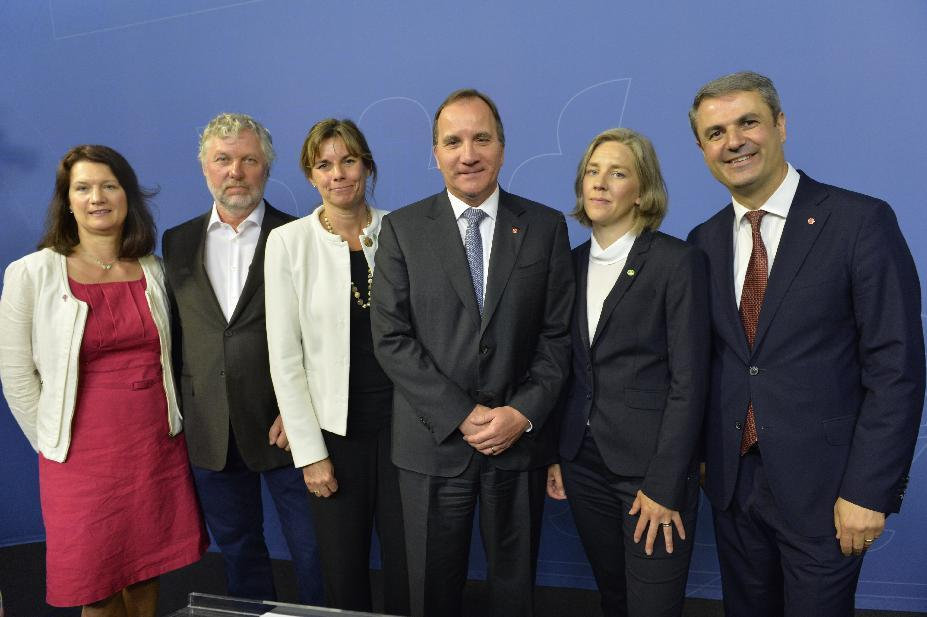 Swedish Prime Minister Stefan Lofven, centre, poses with members of his new Cabinet, with left to right, Ann Linde EU and trade; Peter Eriksson housing and digitizing; Isabella Lovin international development and climate; Prime Minister Stefan Lofven, Karolina Skog environment; Ibrahim Baylan coordination and energy, during a press conference after a government reshuffle Wednesday May 25, 2016. (Jonas Ekstromer / TT via AP) SWEDEN OUT