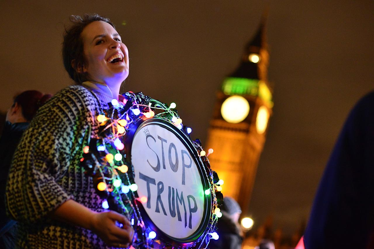 <p>A protester holds up a placard during a rally against U.S. President Donald Trump, Feb. 20, 2017, in London. (Photo: Dominic Lipinski/PA Images via Getty Images) </p>
