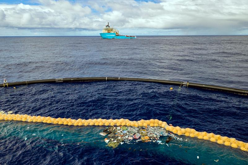 The huge floating device was designed by Dutch scientists to clean up an island of rubbish in the Pacific Ocean (AP)