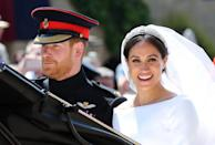 <p>Meghan wore the Queen Mary's diamond bandeau tiara, which was loaned to her by the Queen.(Getty) </p>