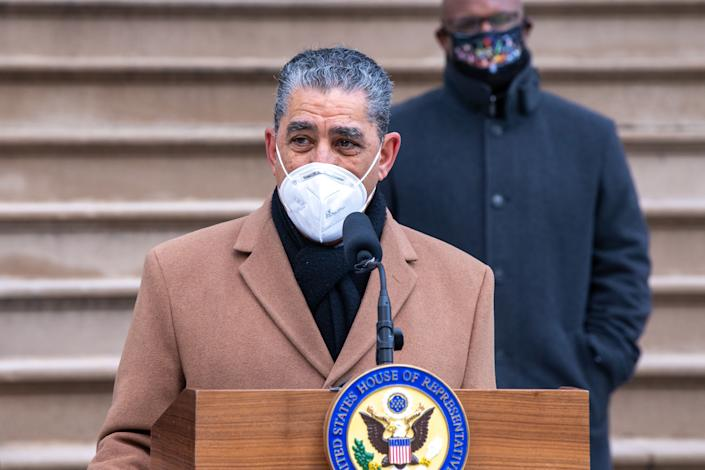 Congressman Adriano Espaillat (D-NY) wearing a face mask speaks during a press conference at City Hall in New York City in January. (Ron Adar/SOPA Images via ZUMA Wire)