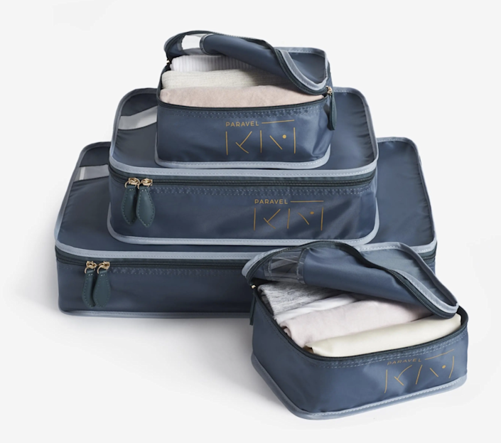 """After the investment suitcase, I finally went for the packing cubes, which feel very sophisticated. Marie Kondo teamed up with Paravel for a chic version that I have my eye on. $65, Paravel. <a href=""""https://tourparavel.com/products/konmari-x-paravel-packing-cube-quad?variant_id=Z2lkOi8vc2hvcGlmeS9Qcm9kdWN0VmFyaWFudC80MDEwMTg5NjA5Mzg3Mw=="""" rel=""""nofollow noopener"""" target=""""_blank"""" data-ylk=""""slk:Get it now!"""" class=""""link rapid-noclick-resp"""">Get it now!</a>"""
