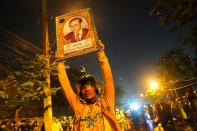A demonstrator holds up a portrait of Thailand's late King Bhumibol Adulyadej during an anti-government in Bangkok