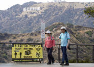 Visitors are seen without face masks at the Griffith Observatory in Los Angeles, Monday, May 17, 2021. California is keeping its rules for wearing face masks in place until the state more broadly lifts its pandemic restrictions on June 15. (AP Photo/Damian Dovarganes)