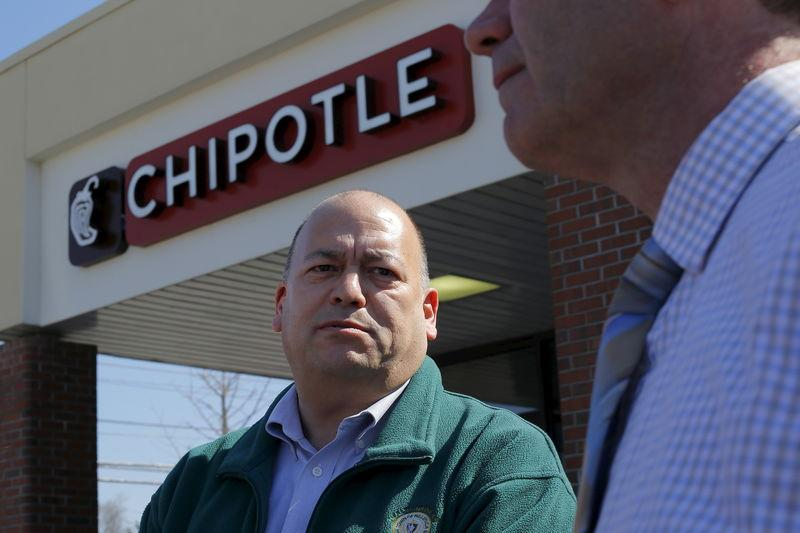Richard Verube, the Director of Public Health in the town of Billerica, speaks toe reporters outside the temporarily closed Chipotle restaurant in Billerica