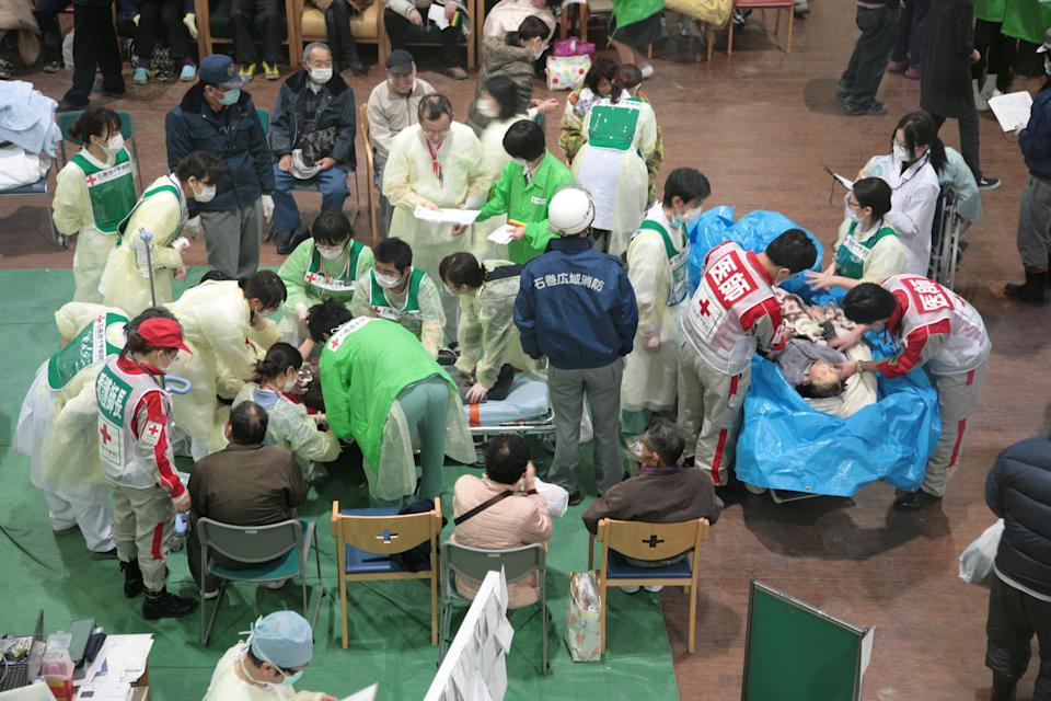 <p>FILE PHOTO: In this handout images provided by the International Federation of Red Cross Japan, patients who suffered near drowning are wrapped in blankets and then plastic sheeting to keep them warm ad dry before being transported to Ichinomaki Red Cross hospital for treatment, after an 9.0 magnitude strong earthquake struck on March 11, off the coast of north-eastern Japan, March 12, 2011 in Japan. (Photo: Toshirharu Kato/Japanese Red Cross/IFRC via Getty Images)</p>