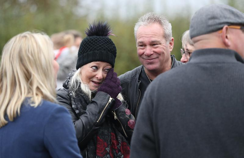 Charlotte Charles (left), the mother of Harry Dunn, and her partner Bruce Charles speak to media after a motorbike convoy followed Harry Dunn's last ride through Brackley as a tribute to the teenager who died when his motorbike was involved in a head-on collision near RAF Croughton, Northamptonshire, in August.