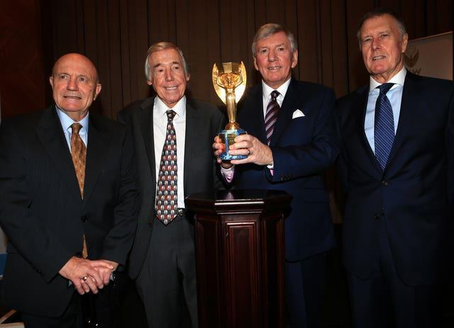 Former England and World Cup winning players (left to right) George Cohen, Gordon Banks, Martin Peters and Sir Geoff Hurst with the Jules Rimet trophy