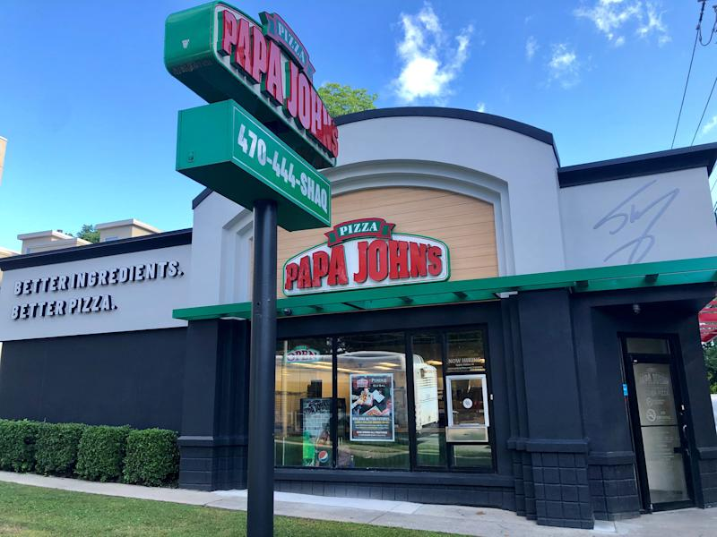 Remodeled Papa John's storefront with Shaquille O'Neal branding
