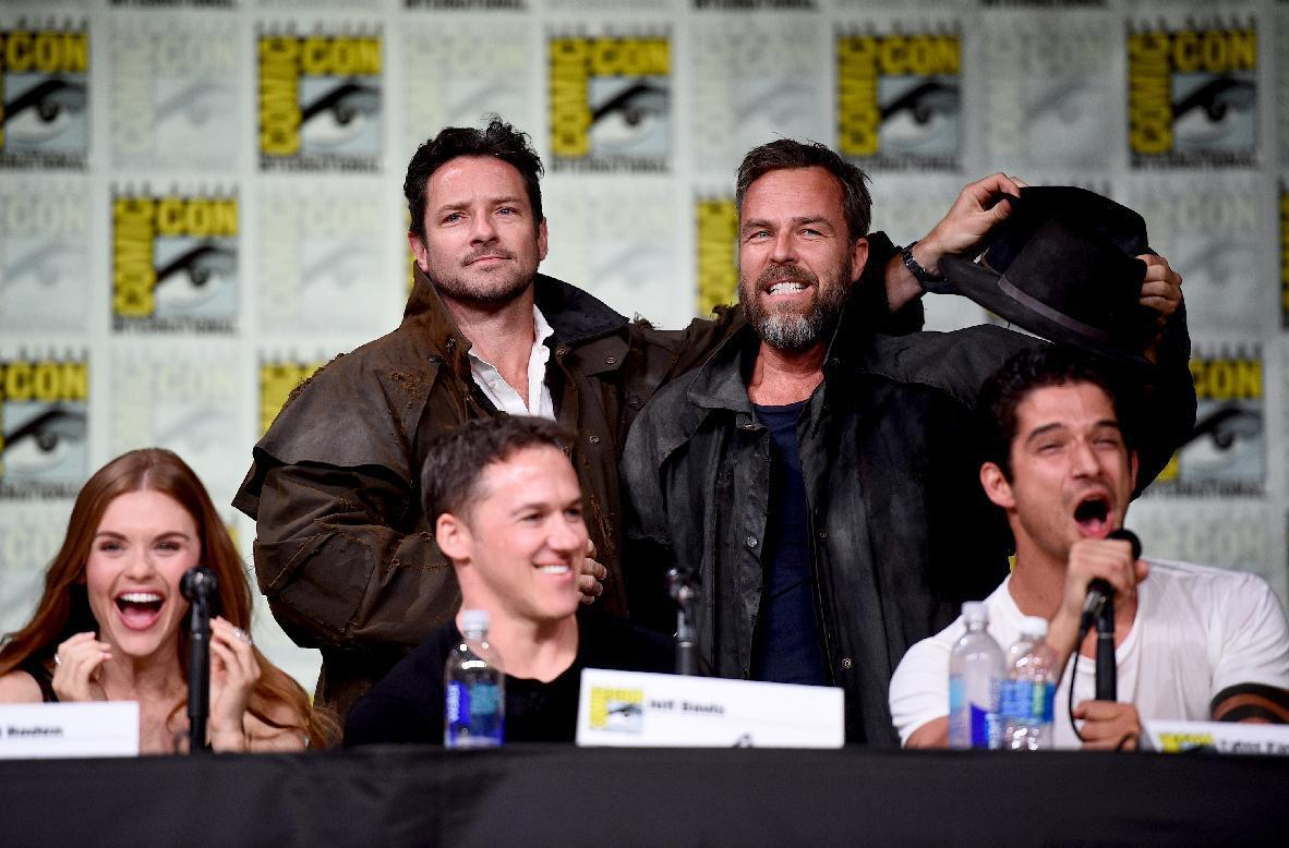 "Holland Roden, from seated left, Jeff Davis and Tyler Posey announce castmates Ian Bohen, from standing left, and J.R. Bourne at the ""Teen Wolf"" panel on day 1 of Comic-Con International on Thursday, July 21, 2016, in San Diego. (Photo by Al Powers/Invision/AP)"