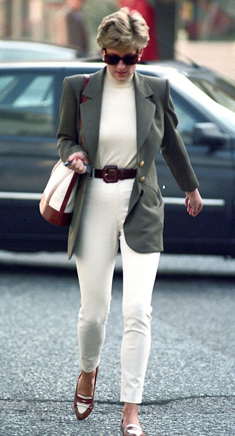 <p>In a gray blazer, white trousers, turtleneck, and loafers while shopping in Knightsbridge. </p>