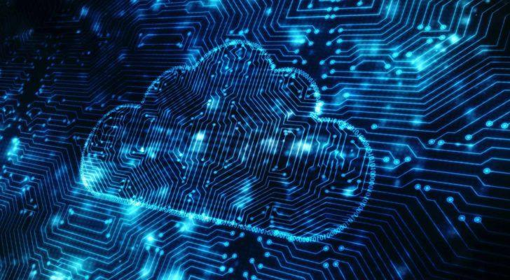 an image of a cloud imprinted on a circuit board lit up by blue circuit lights