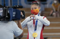 Guan Chenchen, of China, reacts after winning the gold medal on the balance beam during the artistic gymnastics women's apparatus final at the 2020 Summer Olympics, Tuesday, Aug. 3, 2021, in Tokyo, Japan. (AP Photo/Gregory Bull)