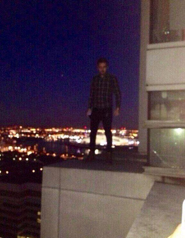 """Liam was forced to apologise to fans over this photo, which showed him standing on a window ledge, overlooking East London. He tweeted: """"You may have seen a photo of me today taken on top of a building. I regret being there and having the photo taken. """"It was a stupid and irresponsible thing to do. I am sorry..."""""""