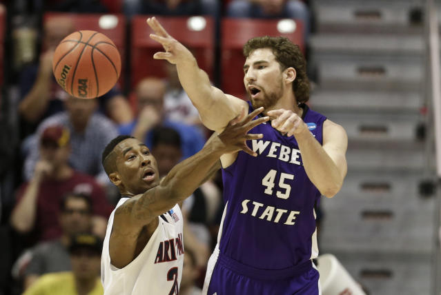 Weber State center James Hajek fires a pass over Arizona forward Rondae Hollis-Jefferson during the first half in a second-round game in the NCAA college basketball tournament Friday, March 21, 2014, in San Diego. (AP Photo/Gregory Bull)