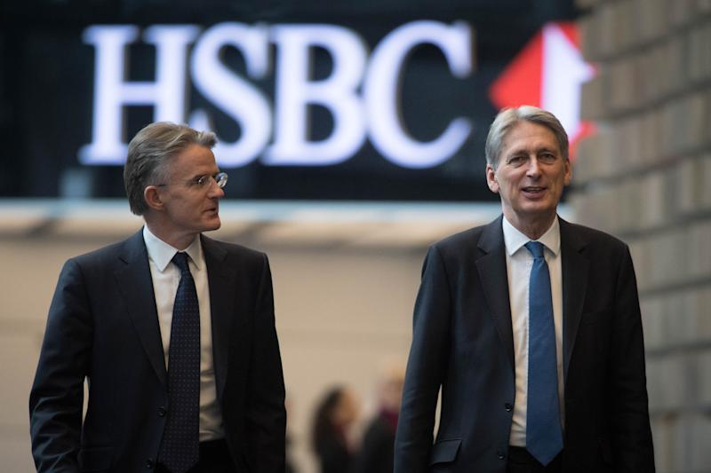 Outgoing HSBC CEO John Flint pictured with former UK Chancellor of the Exchequer Philip Hammond (R). Photo: STEFAN ROUSSEAU/AFP/Getty Images