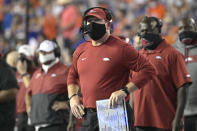 Arkansas acting head coach Barry Odom, center, watches a stadium video monitor after Florida scored a touchdown during the first half of an NCAA college football game, Saturday, Nov. 14, 2020, in Gainesville, Fla. (AP Photo/Phelan M. Ebenhack)