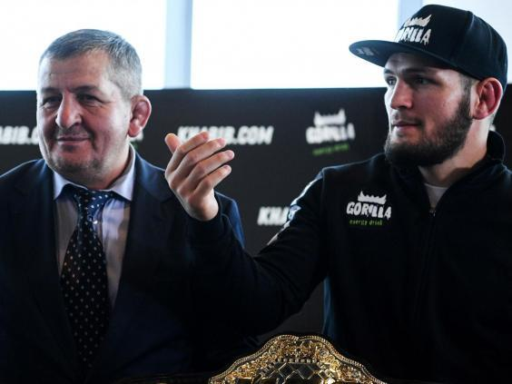 Abdulmanap Nurmagomedov (left) died from complications caused by coronavirus (AFP via Getty Images)