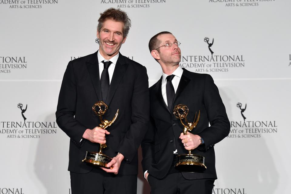 """US screenwriters David Benioff (L) and D. B. Weiss (R) pose in the press room with the award for """"Founders Award"""" for """"Game of Thrones"""" during the 47th Annual International Emmy Awards at New York Hilton on November 25, 2019 in New York City. - The International Emmy Award is an award ceremony bestowed by the International Academy of Television Arts and Sciences in recognition to the best television programs initially produced and aired outside the United States. (Photo by Angela Weiss / AFP) (Photo by ANGELA WEISS/AFP via Getty Images)"""