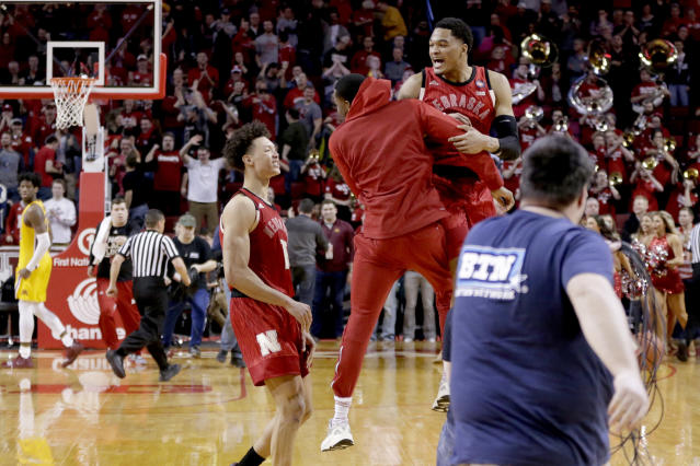 Nebraska's James Palmer Jr., right, celebrates with teammates including Isaiah Roby, left, following an NCAA college basketball game against Minnesota in Lincoln, Neb., Wednesday, Feb. 13, 2019. Palmer made two free throws with 1.1 seconds left to give Nebraska a 62-61 win over Minnesota, ending the Cornhuskers seven-game losing streak. (AP Photo/Nati Harnik)