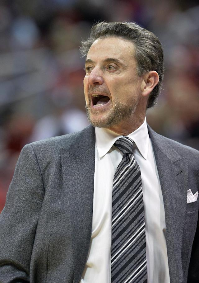 Louisville coach Rick Pitino shouts instructions to his team during the second half of an NCAA college basketball game against Tempkle, Thursday, Feb. 27, 2014, in Louisville, Ky. Louisville defeated Temple 88-66. (AP Photo/Timothy D. Easley)