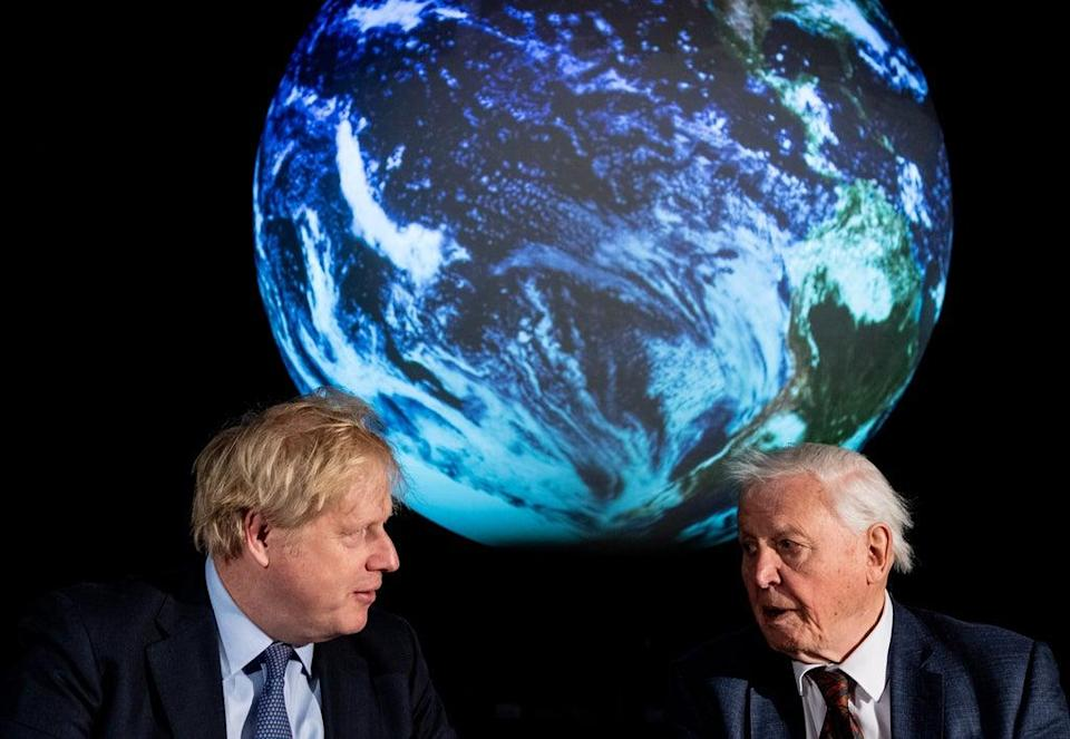 Prime Minister Boris Johnson, left, and Sir David Attenborough at the launch of the Cop26 UN Climate Summit (Chris J Ratcliffe/PA) (PA Archive)