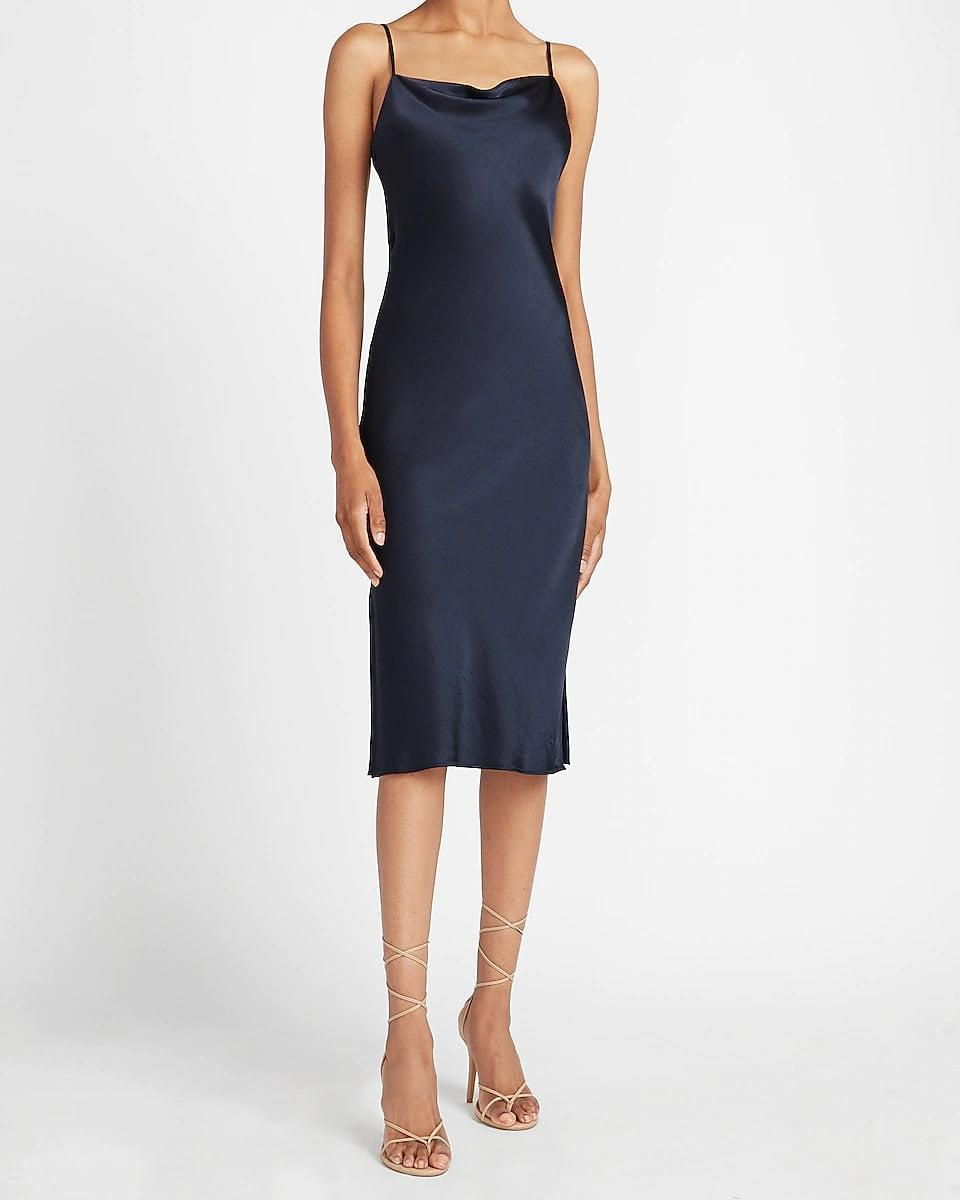 <p>Pair this <span>Express Satin Cowl Neck Midi Slip Dress</span> ($88) with a plaid or solid blazer for an office-ready look. It's chic, effortless, and easy to wear. Keep the rest of the look simple with some slides or low-heeled mules.</p>