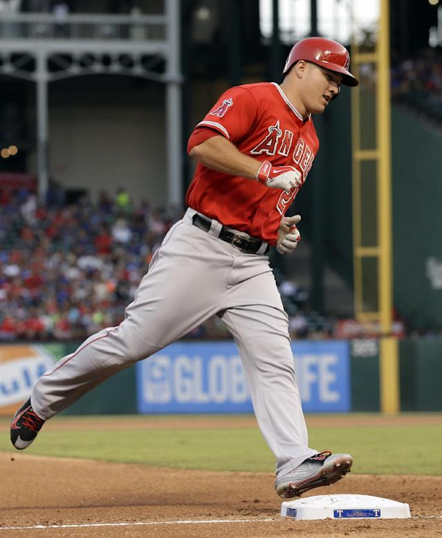 Los Angeles Angels' Mike Trout rounds third on his way home after hitting a solo home run off of Texas Rangers starting pitcher Nick Tepesch in the fourth inning of a baseball game, Friday, July 11, 2014, in Arlington, Texas. (AP Photo/Tony Gutierrez)