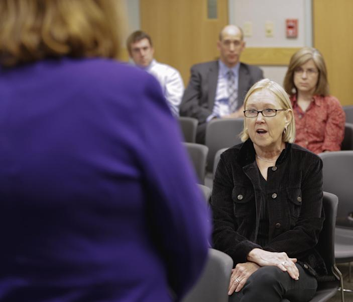 In this photo taken April 29, 2013, Susan Gumm of Omaha, Neb., right, asks Sen. Deb Fischer, R-Neb., a question about immigration reform, during a town meeting in Nebraska City, Neb. Gumm said Republicans who advocate writing new law over enforcing statutes on the books are giving up on a key tenet of the GOP, and will destroy the Republican Party. (AP Photo/Nati Harnik)
