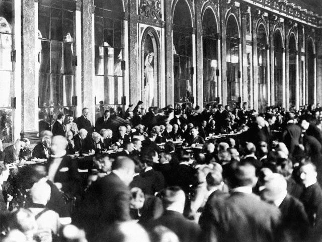Officials sign the peace terms of the treaty at Versailles