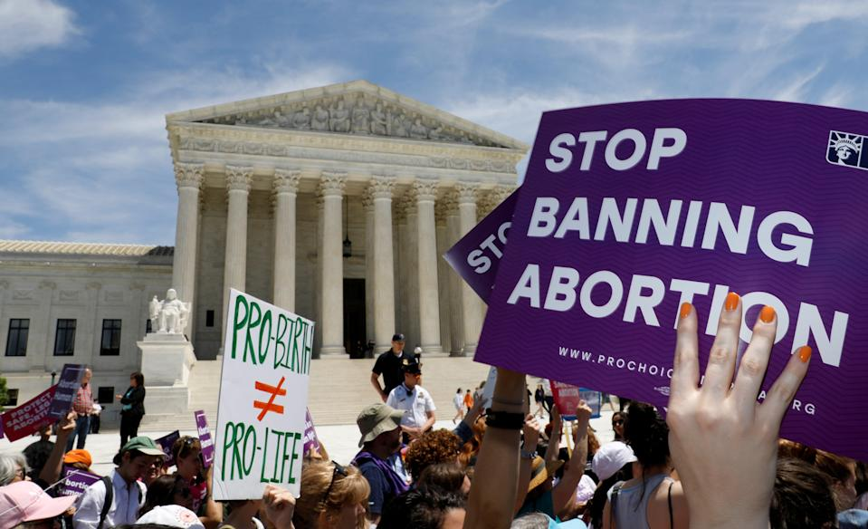 Abortion rights activists rally outside the US Supreme Court in Washington DC. (REUTERS)