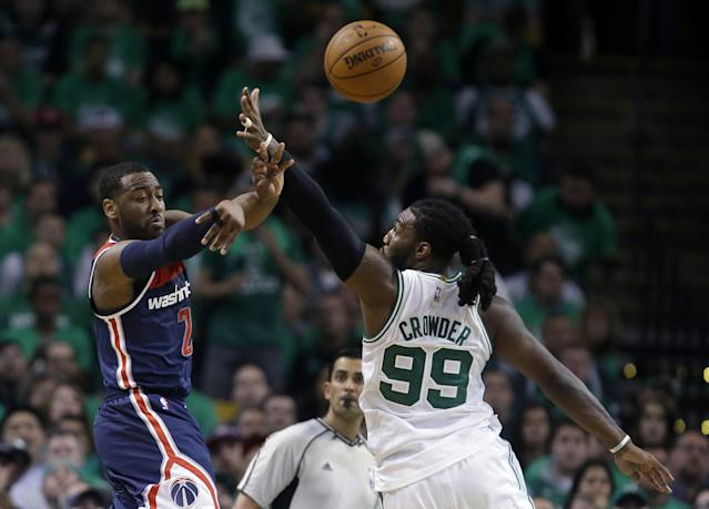 <p>Washington Wizards guard John Wall, left, delivers a pass as Boston Celtics forward Jae Crowder defends during the second quarter of Game 7 of a second-round NBA basketball playoff series, Monday, May 15, 2017, in Boston. (AP Photo/Charles Krupa) </p>