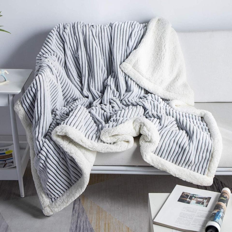 <p>Stay cozy in this <span>DISSA Sherpa Fleece Blanket</span> ($25).</p>