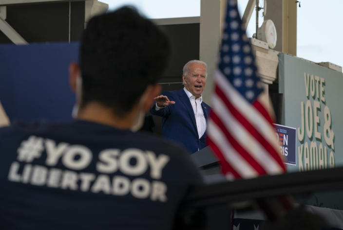 Democratic presidential candidate former Vice President Joe Biden speaks at Miramar Regional Park in Miramar, Fla., Tuesday Oct. 13, 2020, as supporters watch from their cars. (AP Photo/Carolyn Kaster)
