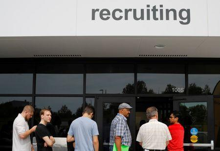 """FILE PHOTO - Job seekers line up to apply during """"Amazon Jobs Day,"""" a job fair being held at 10 fulfillment centers across the United States aimed at filling more than 50,000 jobs, at the Amazon.com Fulfillment Center in Fall River, Massachusetts, U.S., August 2, 2017.   REUTERS/Brian Snyder"""