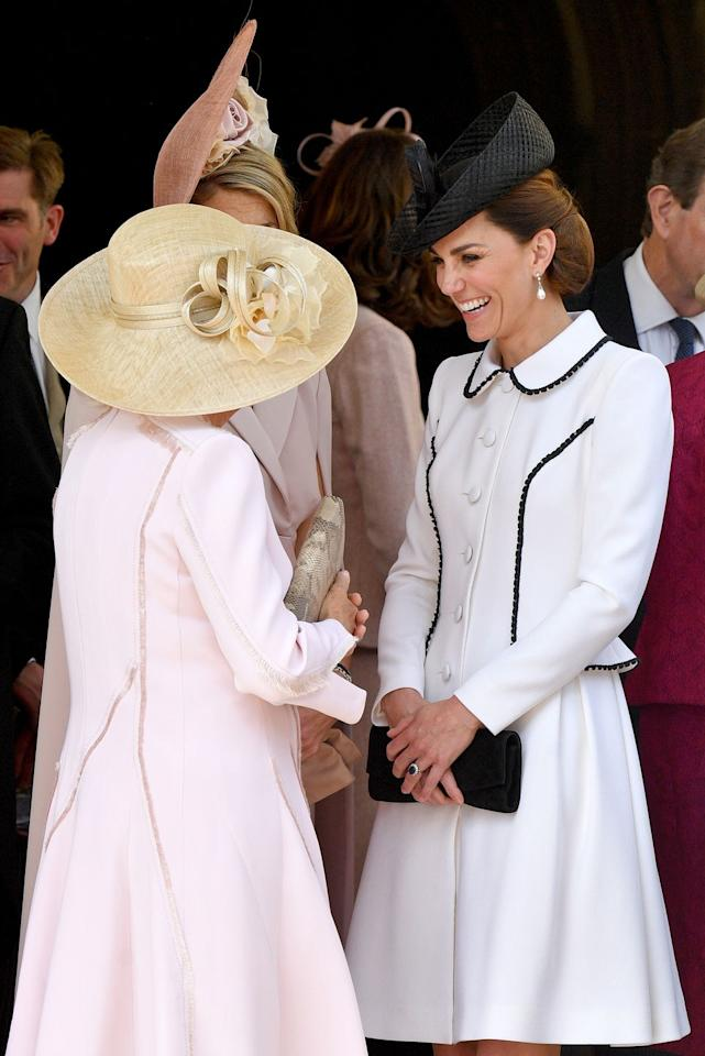 <p>Kate appears to enjoy one of Camilla's jokes at the annual Order of the Garter service.<br></p>