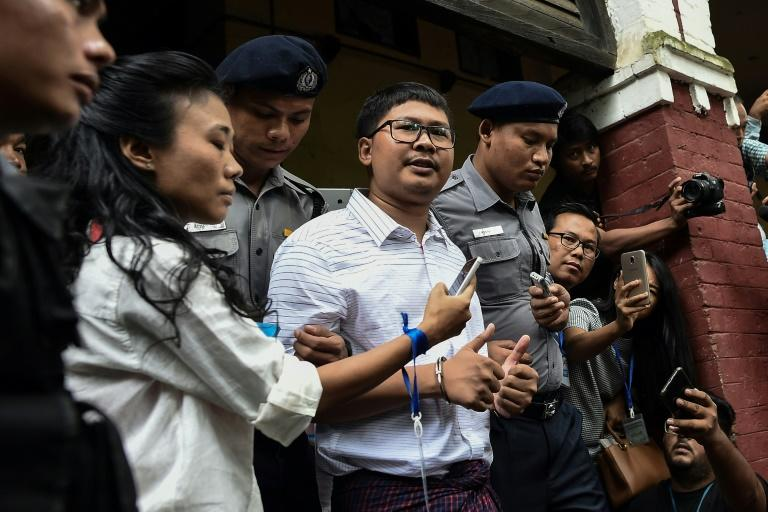 Detained Reuters correspondent Wa Lone (centre) speaks to journalists in Yangon on August 27, 2018