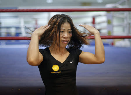 FILE PHOTO: India's boxer MC Mary Kom gestures during an interview with Reuters at Balewadi Stadium in Pune, about 190 km (118 miles) from Mumbai, March 12, 2012. REUTERS/Danish Siddiqui