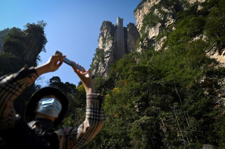 Tourists can zip up the cliff in just 88 seconds -- or brave a three hour climb to the top