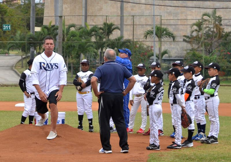 Tampa Ray Bays pitching coach Hickey holds a baseball clinic with Cuban children in Havana