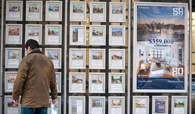 A prospective buyer browses property listings in New York. Photo: Alamy