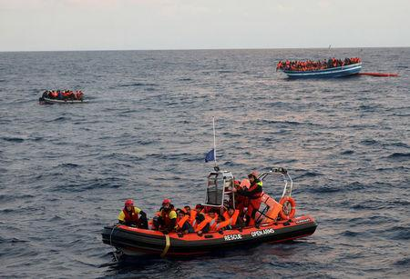 Migrants overcrowd a wooden vessel in central Mediterranean Sea