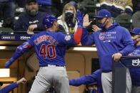 Chicago Cubs' Willson Contreras celebrates with manager David Ross after hitting a two-run home run during the eighth inning of a baseball game against the Milwaukee Brewers Tuesday, April 13, 2021, in Milwaukee. (AP Photo/Morry Gash)