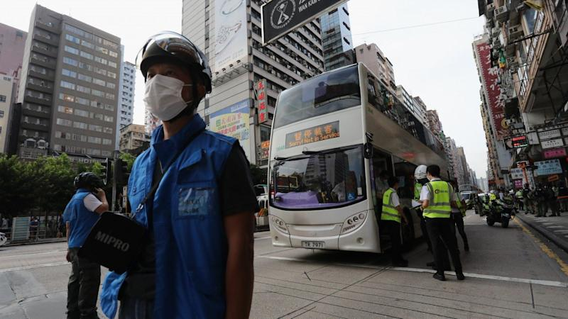 Hong Kong bus driver charged with careless driving after police accused him of endangering officers during protest operation