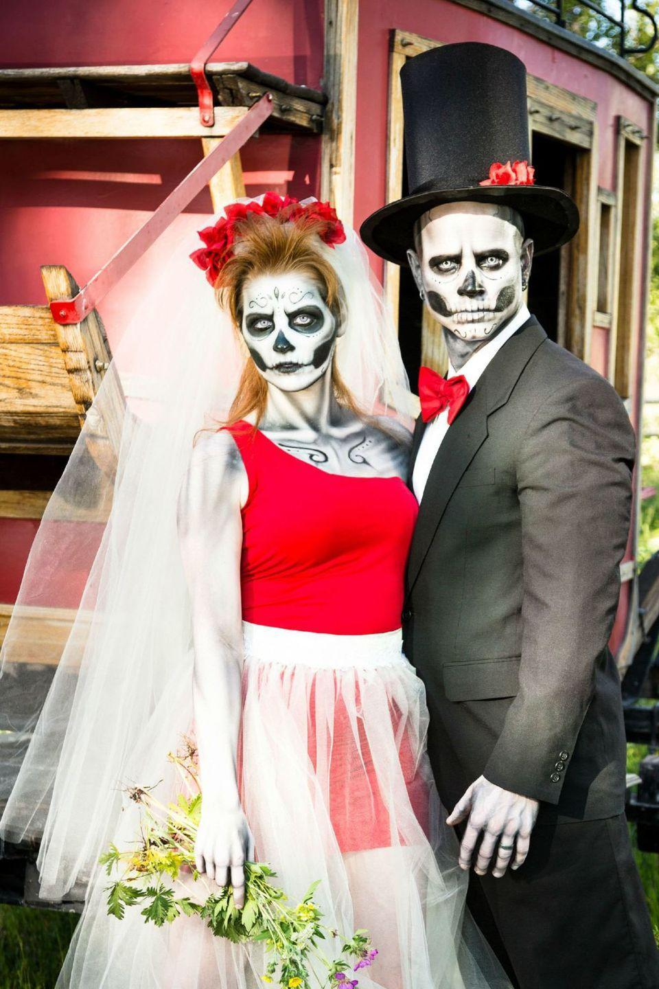 """<p>If you don't want to dress up as a typical bride and groom, you can pair <a href=""""https://www.goodhousekeeping.com/holidays/halloween-ideas/g2599/halloween-costumes-with-makeup-ideas/"""" rel=""""nofollow noopener"""" target=""""_blank"""" data-ylk=""""slk:skeleton makeup"""" class=""""link rapid-noclick-resp"""">skeleton makeup</a> with any formal attire look spooky on Halloween.</p><p><a class=""""link rapid-noclick-resp"""" href=""""https://www.amazon.com/Dress-Up-America-Non-Toxic-Crayons/dp/B01CFHSA0M/?tag=syn-yahoo-20&ascsubtag=%5Bartid%7C10055.g.2625%5Bsrc%7Cyahoo-us"""" rel=""""nofollow noopener"""" target=""""_blank"""" data-ylk=""""slk:SHOP FACE CRAYONS"""">SHOP FACE CRAYONS</a> </p>"""