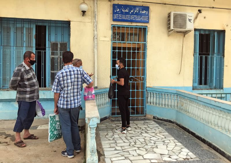 People stand outside an infectious diseases department at Boufarik Hospital